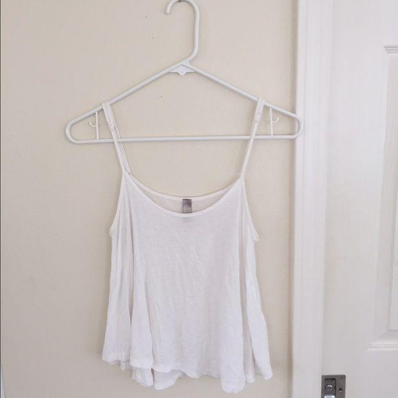 Mahina white tank Brand: mahina It is from a small, expensive store where I live Super soft Loose fit  Perfect condition Brandy Melville Tops Tank Tops