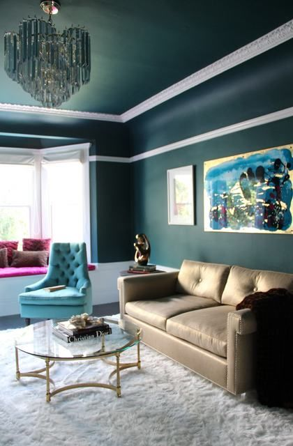 A bold wall and ceiling colour with white trim and crown molding  --- cool color