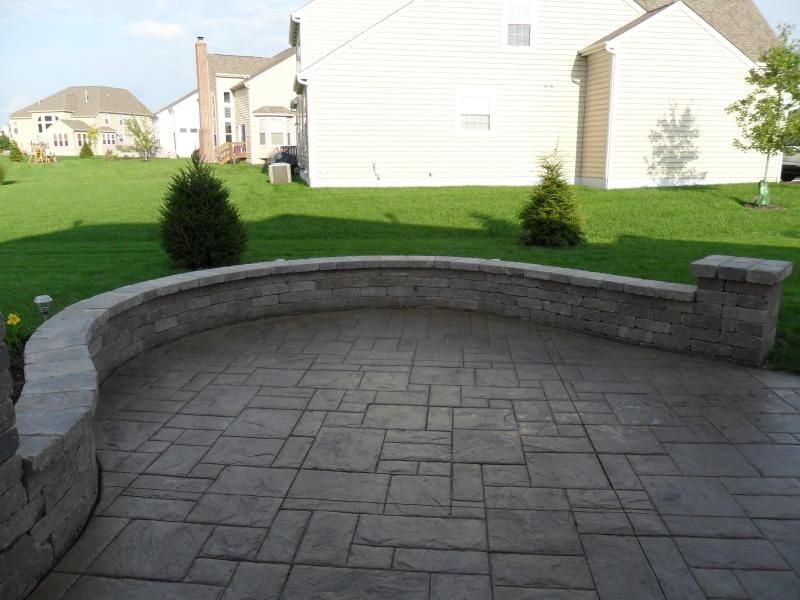 stamped concrete patio with sitting wall gardening patios decks
