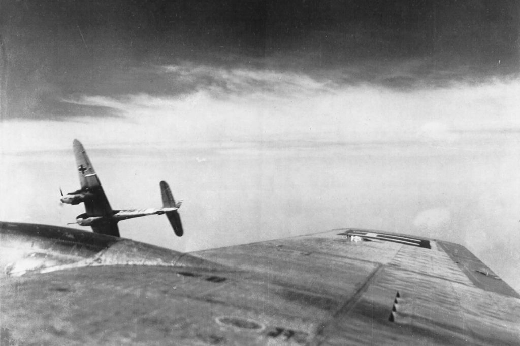 In this photograph taken by a B-17 radio operator during a sortie to Brux, near the border of Czechoslovakia, a Luftwaffe Me-410 is seen pulling away to begin its diving attack. Note the 50mm BK-5 cannon mounted in the nose; the BK-5 had a range of 1,000 yards, meaning the aircraft could attack before it was in range of the bomber's guns.