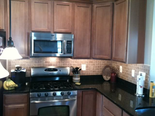 Toffee cabinets, black granite, sandy brick tile ... on Backsplash Maple Cabinets With Black Countertops  id=68049