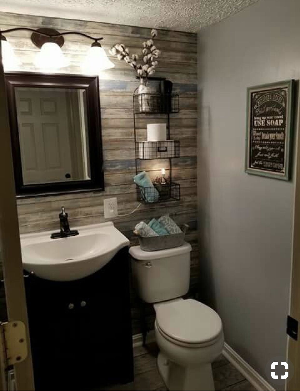 The wall of hardwood is a great accent also great use of - Half bathroom decor ideas ...