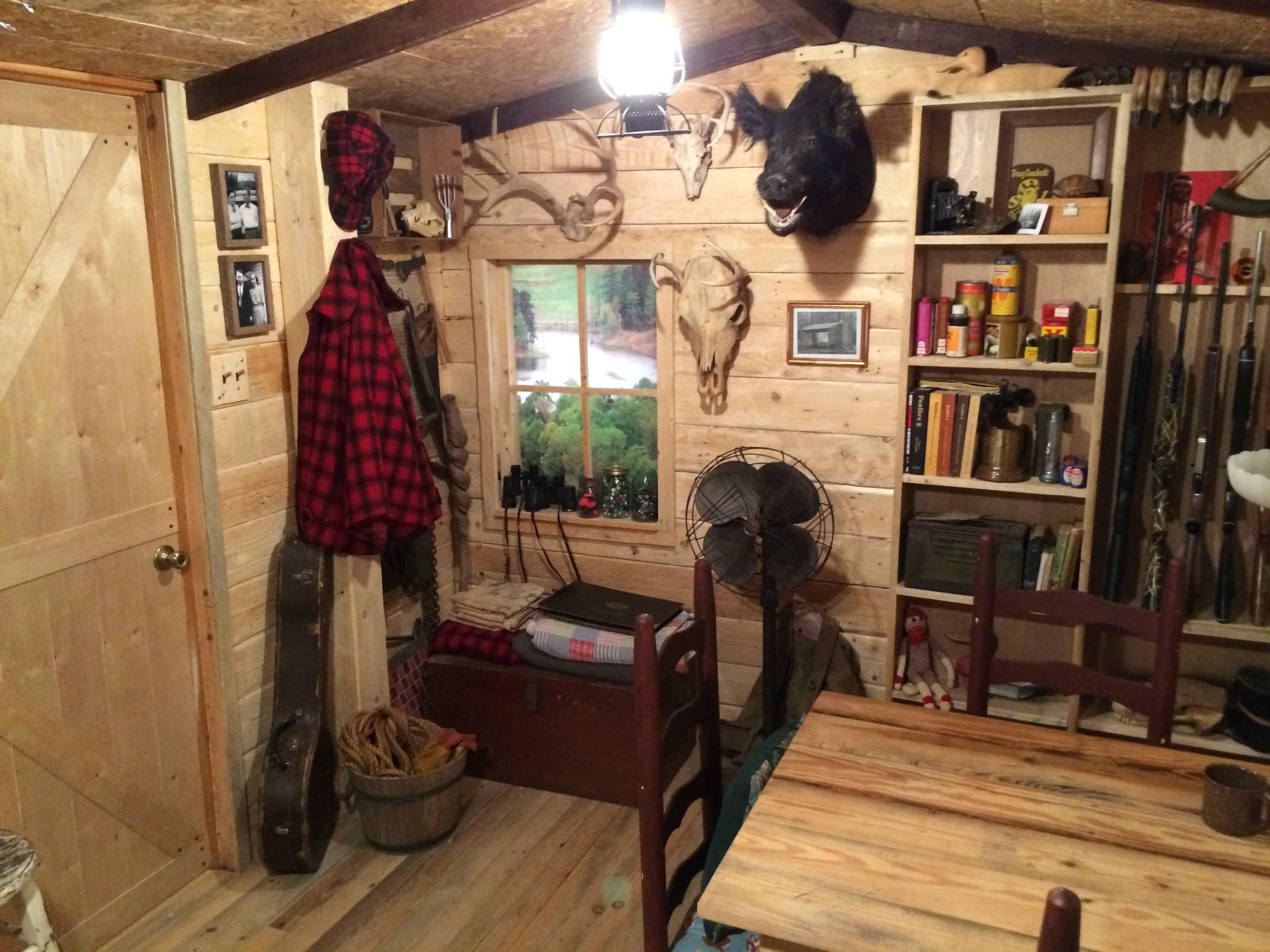 Manly makeover from unfinished basement to rustic log for Log cabin basement ideas