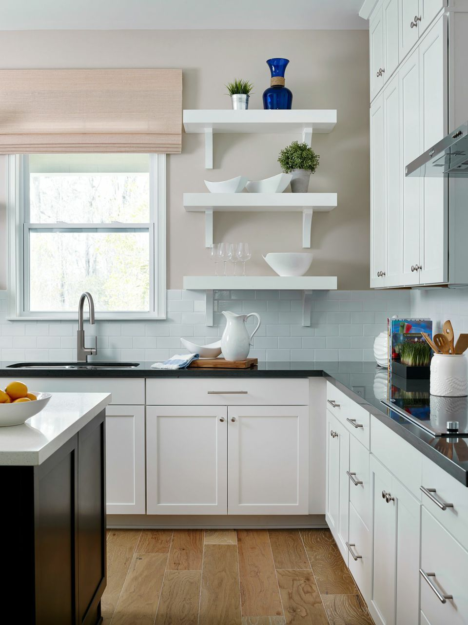 Create a crisp clean look in your kitchen with white wooden cabinets ...
