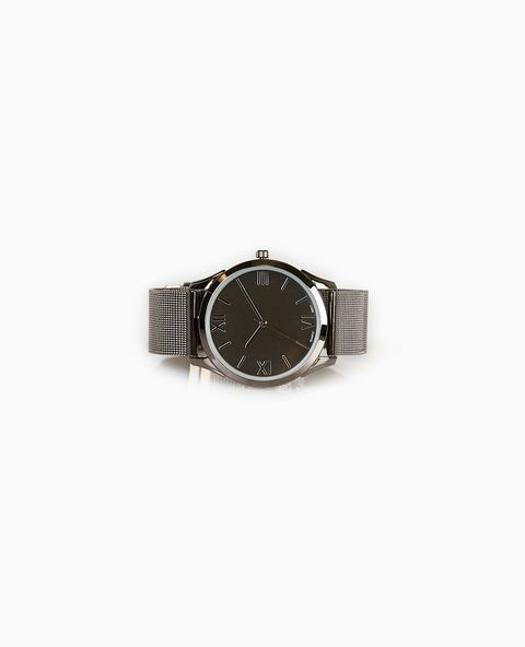 "<p>Always stay on time with this stylish watch. Details include a shiny metal bezel with a clean face, Roman numeral time markers, and an adjustable mesh band.</p>  <p><strong>Content + Care</strong><br /> One Piece Total<br /> Man Made Materials / Metal<br /> Imported</p>  <p><strong>Size + Fit</strong><br /> 1.25"" Diameter / 0.75"" Width<br /> Buckle Closure</p>"