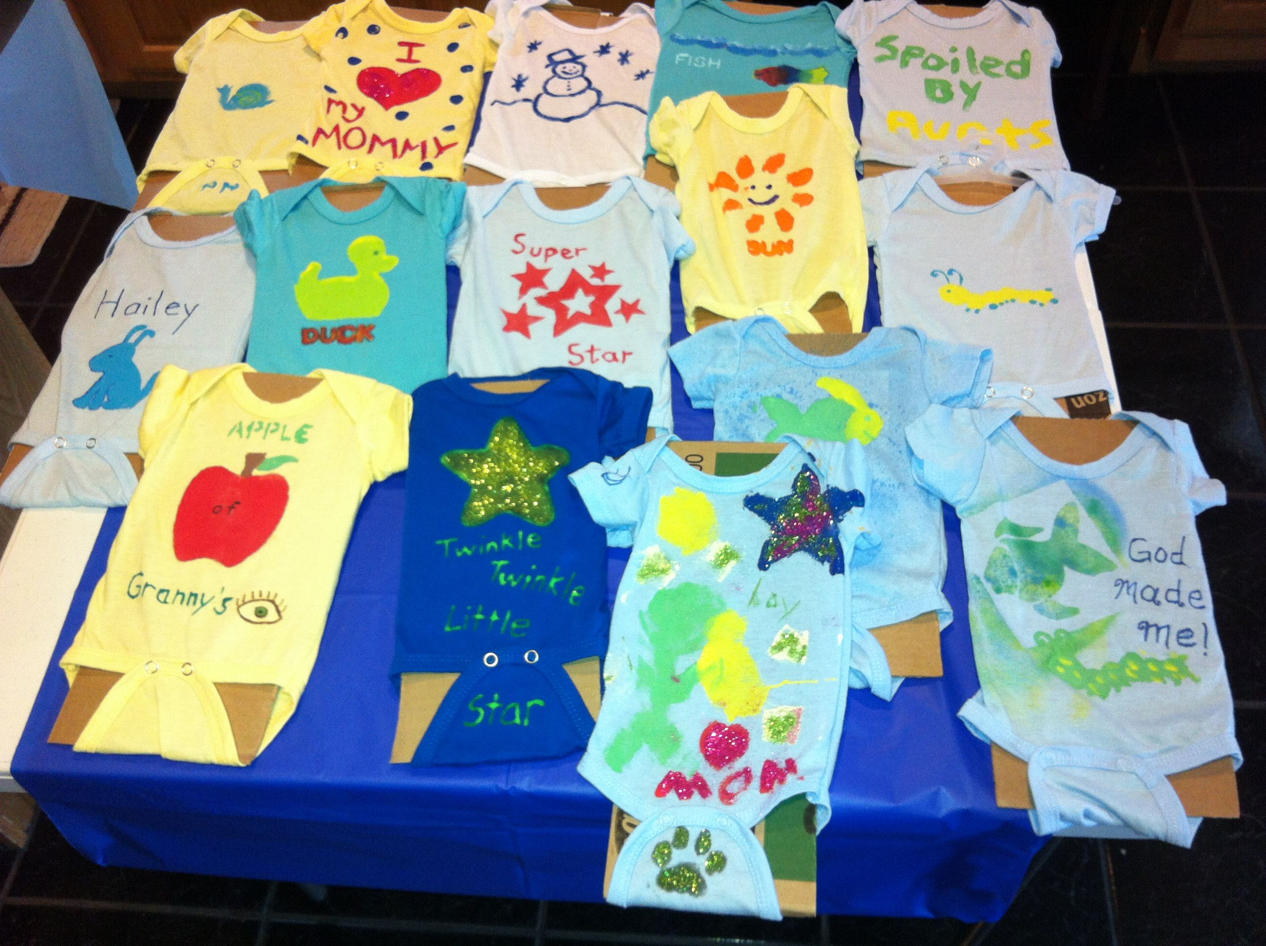Painted Onesies at Baby Shower, so cute, used stencils & fabric markers