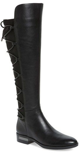 a5425d05d82 ... back of this tall kicky boot outfitted with a half side zipper and a  hidden rand. Color(s)  black leather