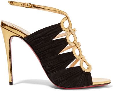 Christian Louboutin's sculptural 'Tina' sandals have been crafted in Italy from gold leather and black suede. This glamorous caged style is designed with ruched sides and the label's signature red lacquered sole. We like them best against a simple LBD.
