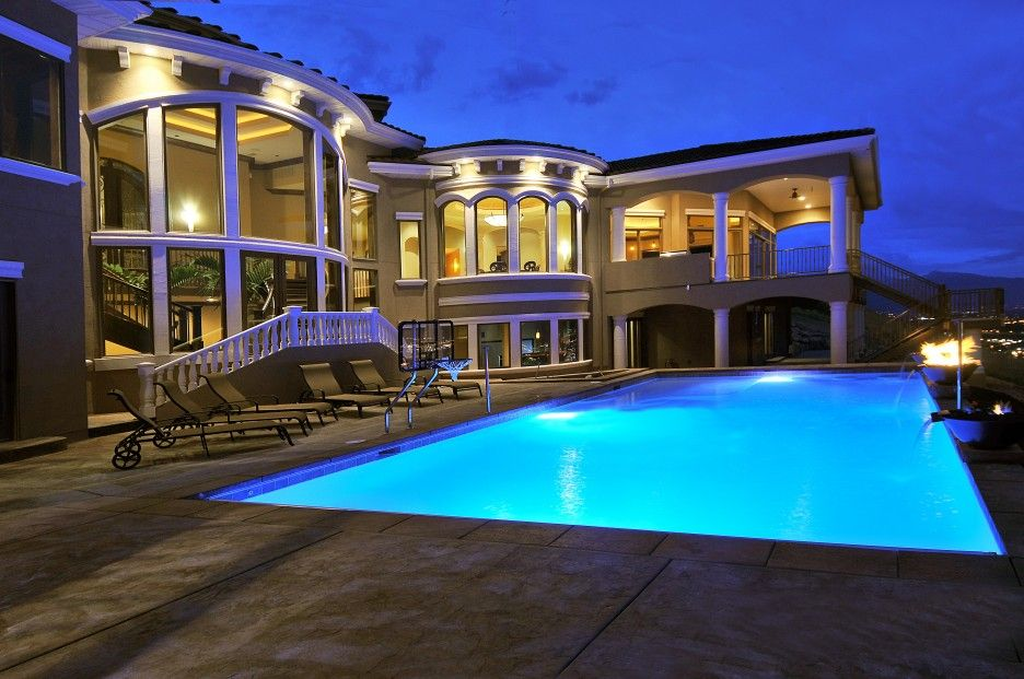 Large swimming pool design applied in front area of for Pool design utah