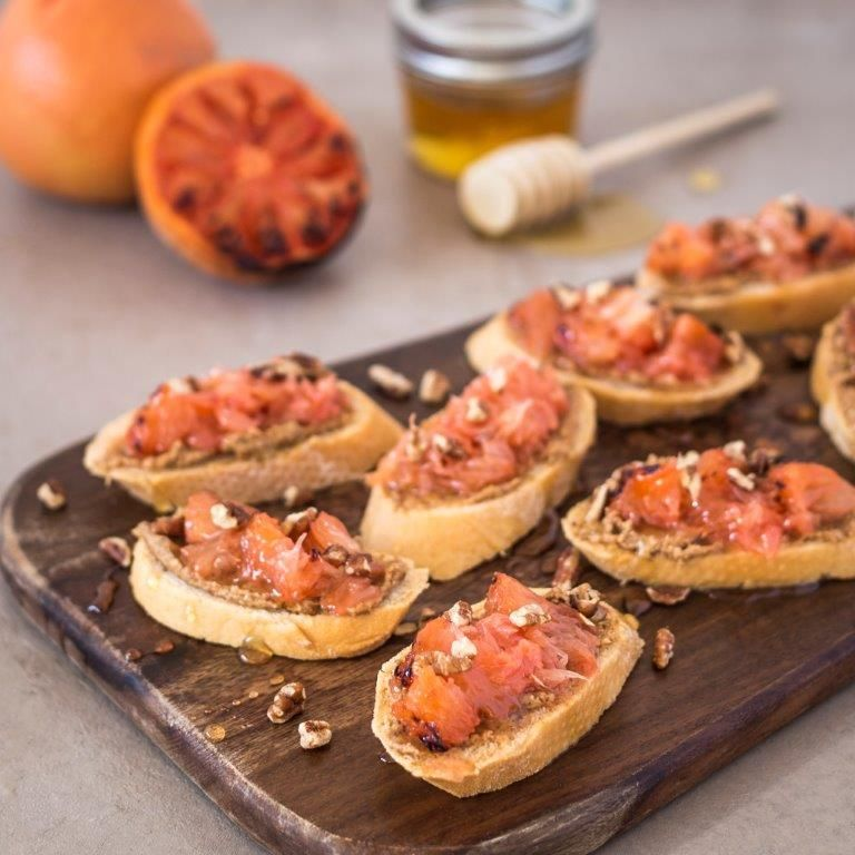 Grapefruit is the great fruit. Try it broiled with a little honey  and nuts for a show-stopping crostini.