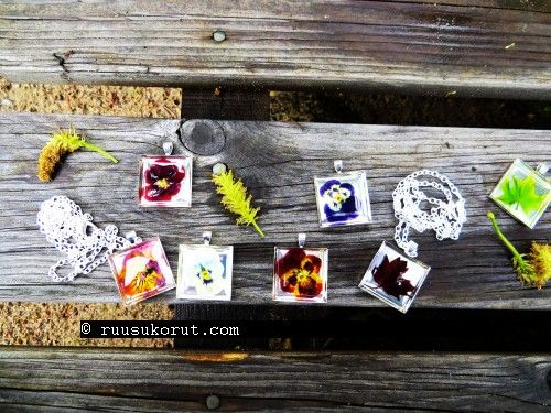 # Ruusukorut.com #Handmade #floverjewellery is made of real, #natural flowers #pansy #pendant 29,90€ #Mapleleaf pendant 29,90€