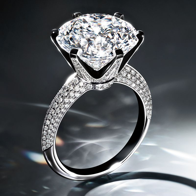 The Tiffany Setting Engagement Ring With Pave Diamond Band In