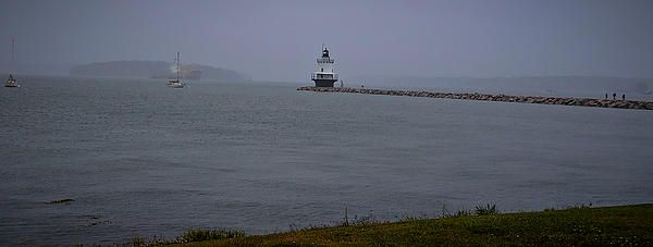 Spring Point Ledge Light The Spring Point Ledge Light was opened to the public on May 22, 1999 for the first time in history. The lighthouse is small but unique in that it's about a mile walking on a stone path to get to the light. Incredible shot of the lighthouse as the fog embraces the light after a stormy day. Spring Point Ledge Lighthouse, South Portland, ME http://deborah-klubertanz.artistwebsites.com/