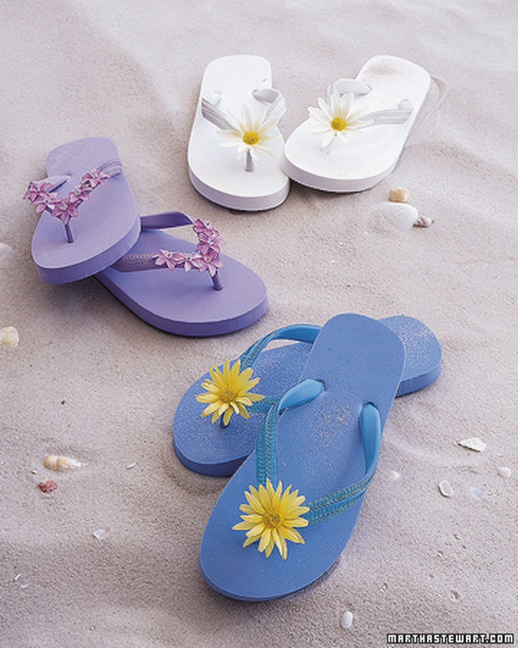 ef309565f17830 Flip-flops adorned with fabric flowers are the perfect accessory for  bright-colored shorts and bathing suits.