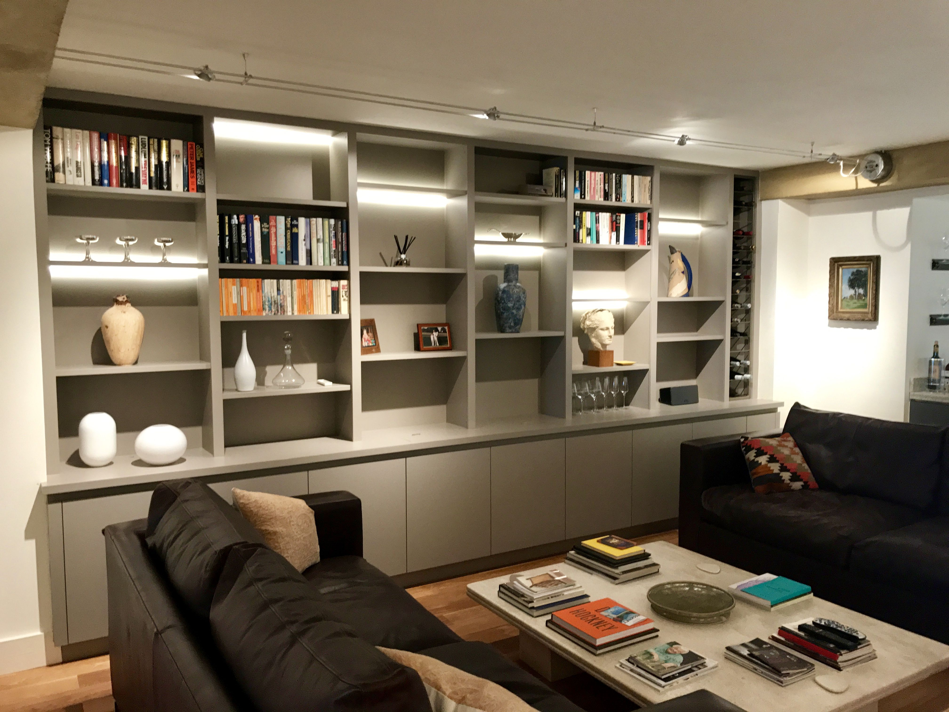 Wall to wall media shelving with cupboard space and led inset
