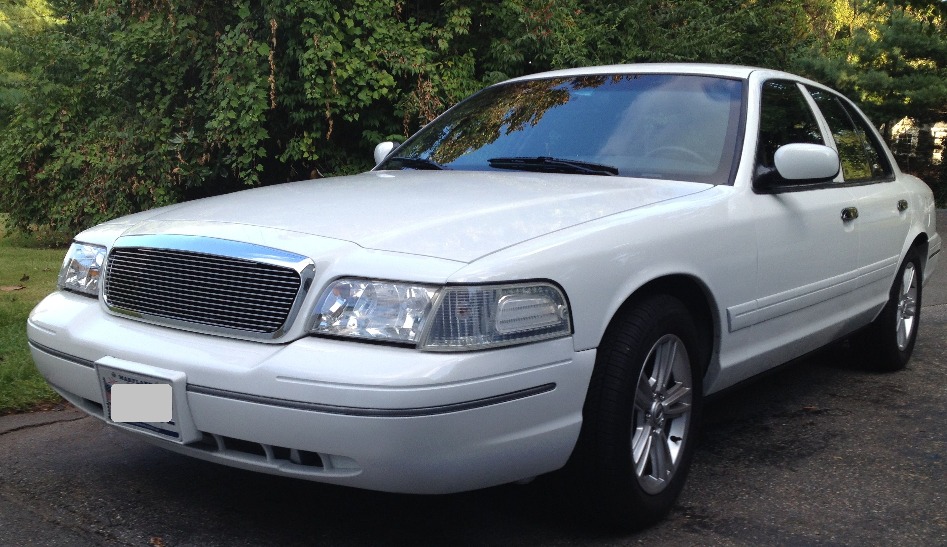 Ford crown victoria with polished billet grille by genx trims