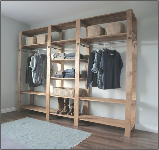 Traditional Bedroom With Unfinished Wood Closet Organizer, Light Blue Rug,  And Six Shelving Wooden