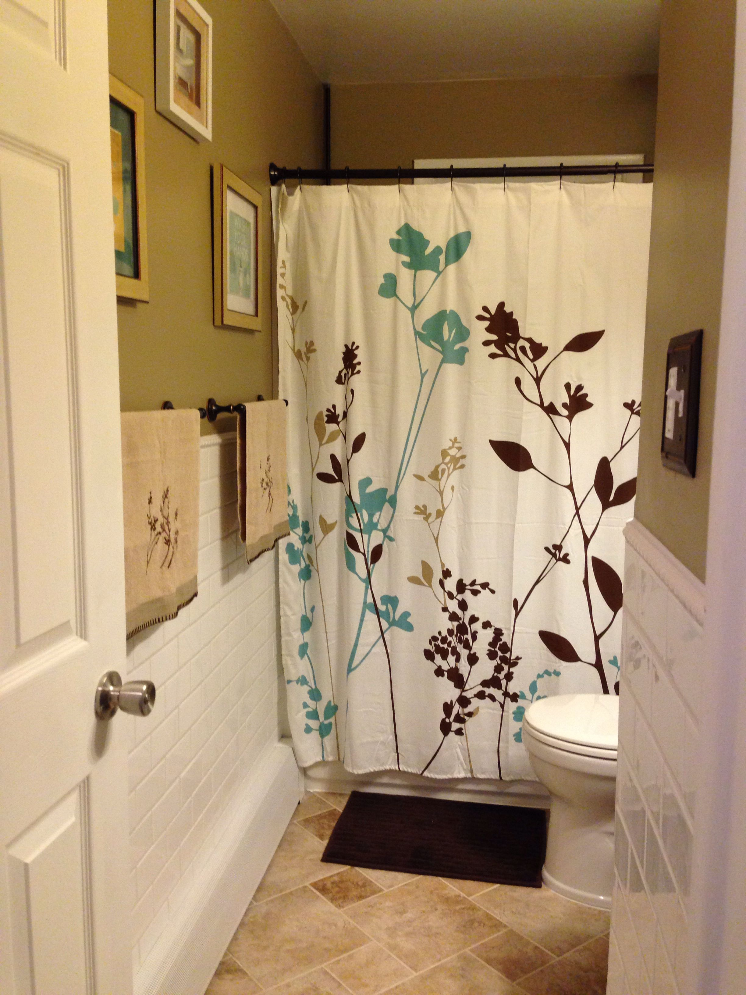 #Remodeled #bathroom. Shower curtain and other #decor from #bedbathandbeyond; vanity, wall and floor tile Lowe's; Home Depot tub and toilet.