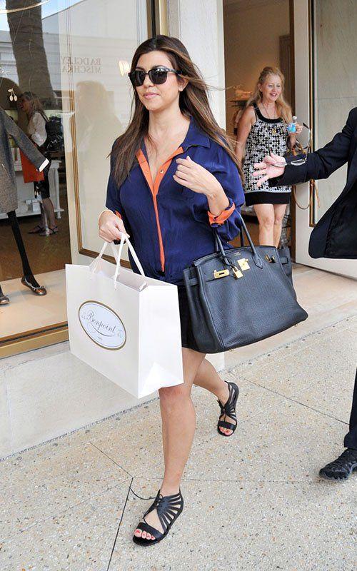 7837cace75d1bf Kourtney Kardashian wearing Greylin Buena B-Color Tie Front Shirt Hermes  Birkin Bag in Black Givenchy Jelly Gillie Wedge Sandals