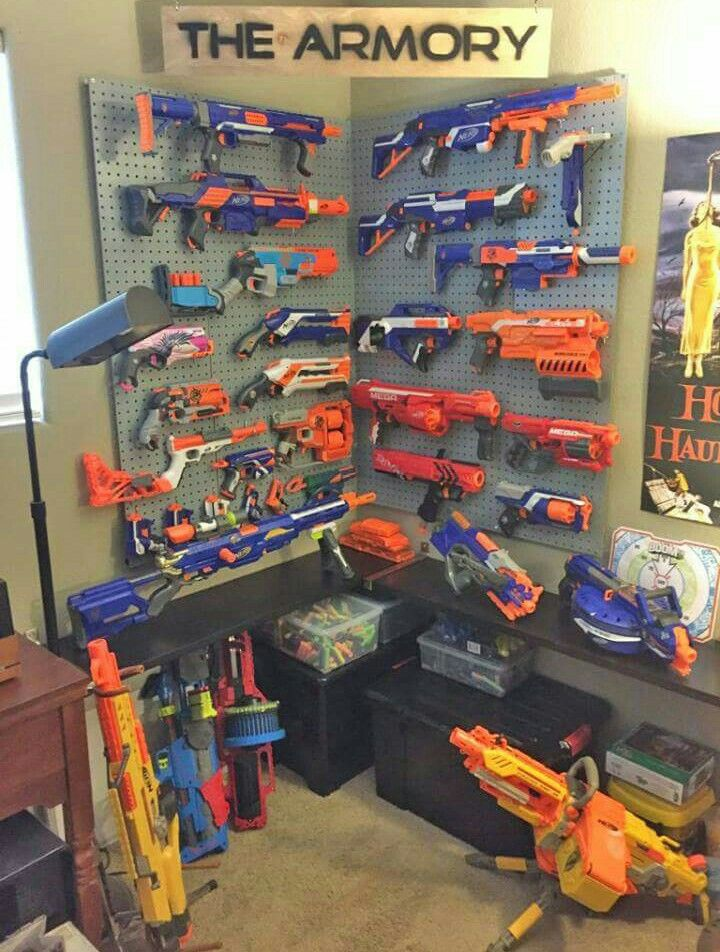Epic nerf gun and squirt gun armoury. Can't wait to set up one