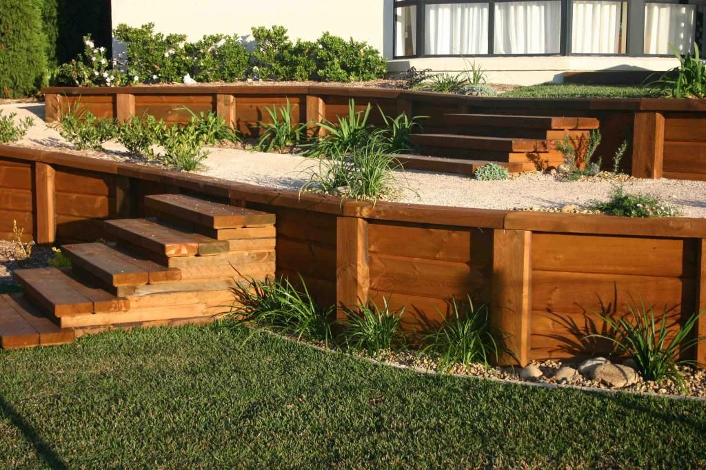 Stunning Retaining Wall Using Landscape Timbers Plus Staircase And Green  Grass For Home Landscaping Ideas