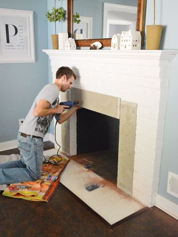 Fireplace makeover tiling the mantel with marble herringbone house diy brick fireplace - Tiling a brick fireplace ...