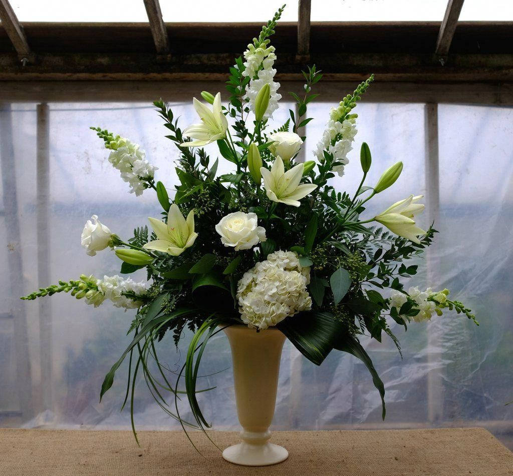 Classic sympathy floral design in all white and green
