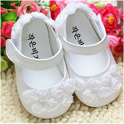 White baby dress shoes.