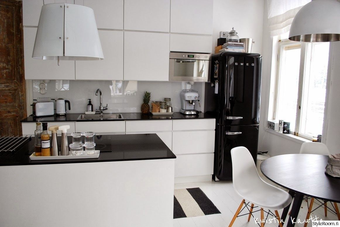 moderni,keittiö,ruokailutilat,keittiötasot,keittiönkaapit,keittiön sisustus,m