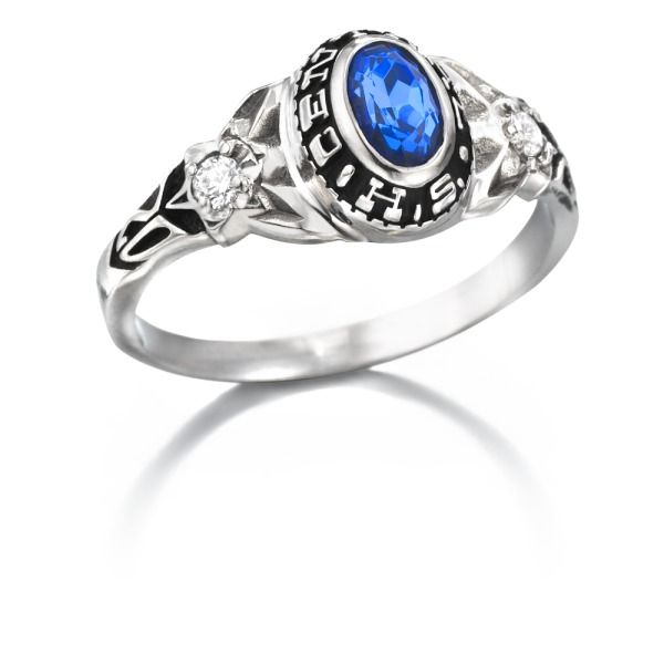 This Delicate Ring Features An Oval Stone Surrounded By