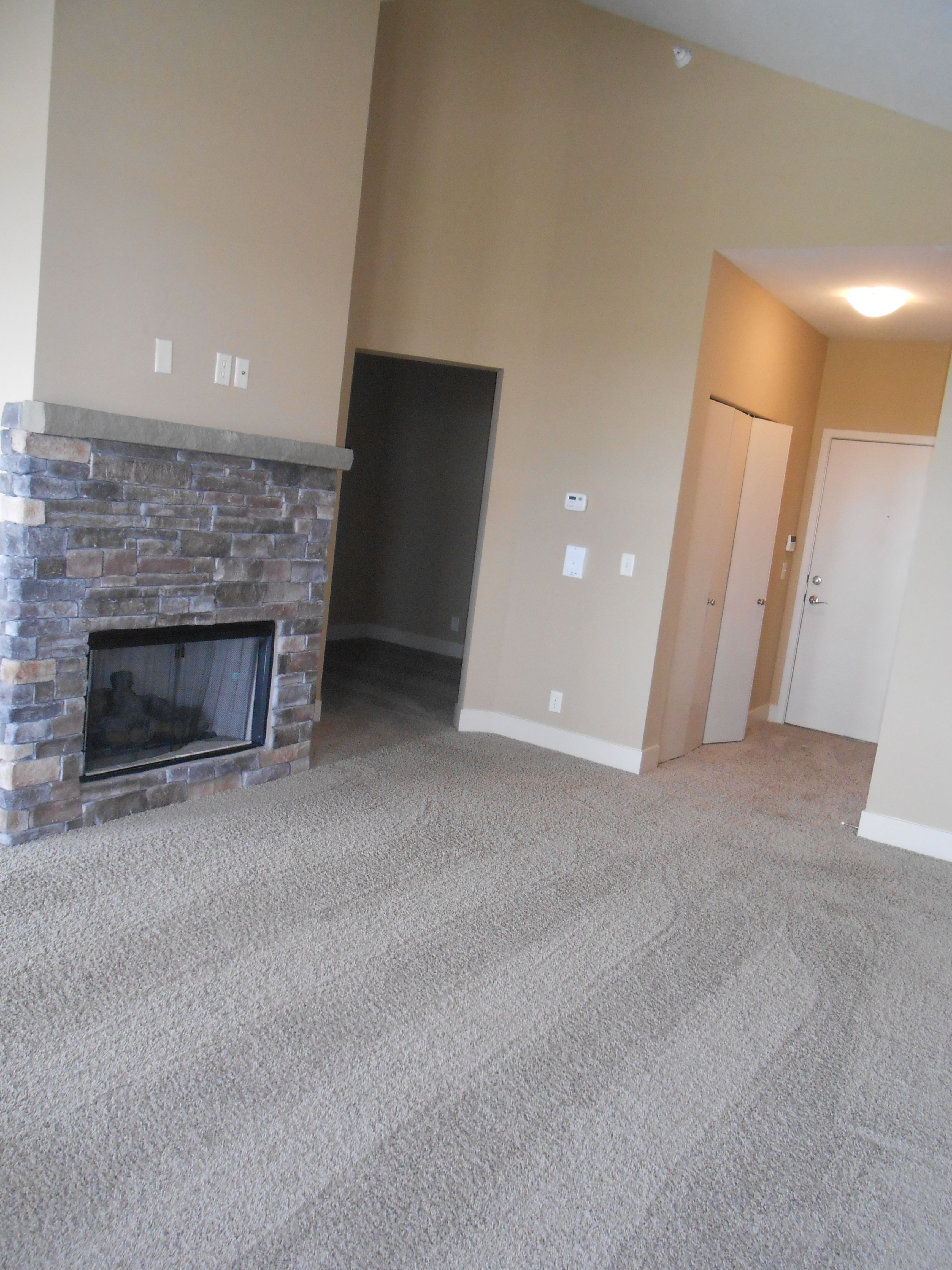 Living Room With Stone Fireplace The Briarwood Broadmoor Hills Affordable Apartments Briarwood Apartment