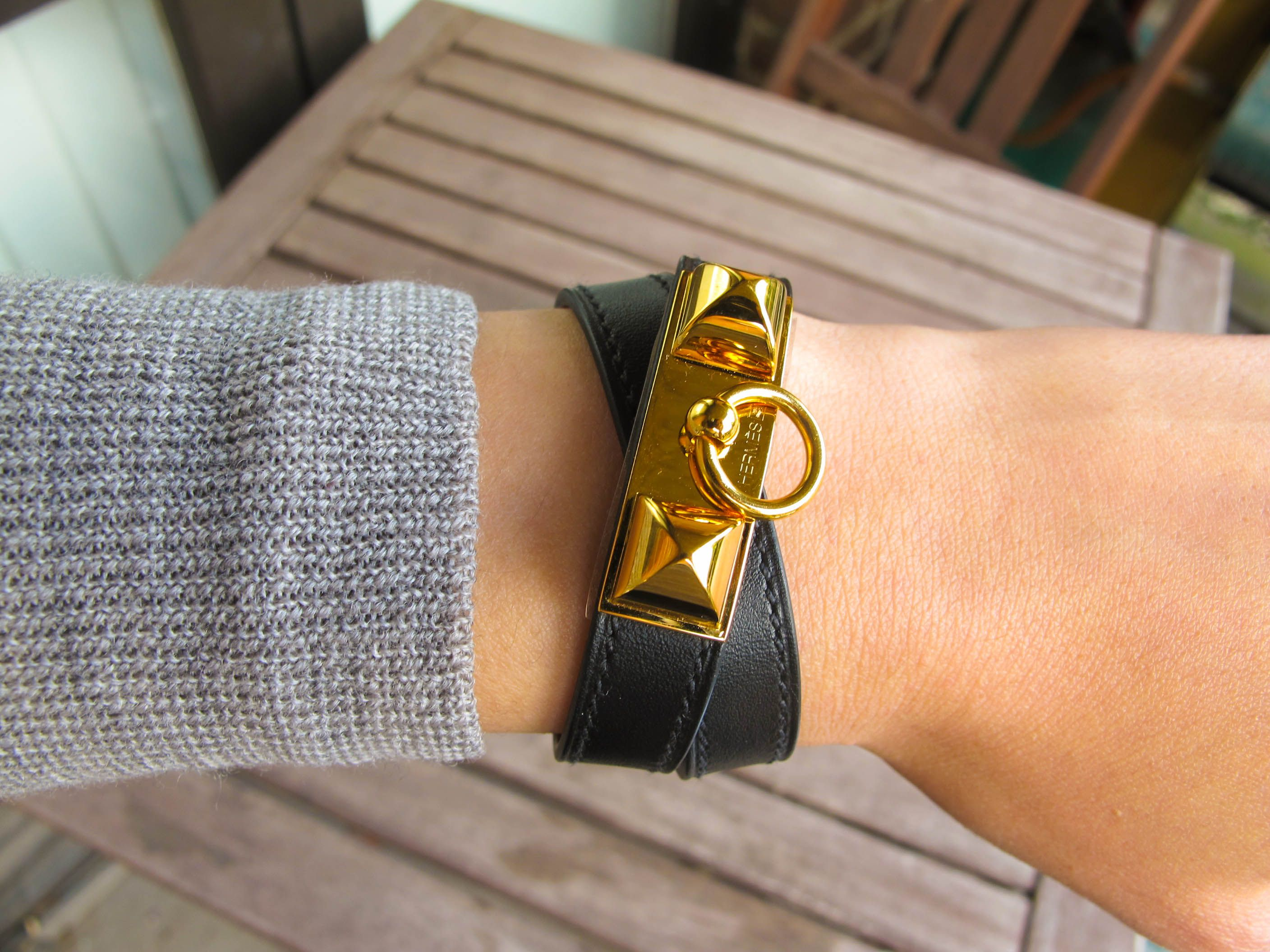 e086f34fa85 Hermes Rivale Leather Wrap Bracelet in Black Leather and Gold Hardware
