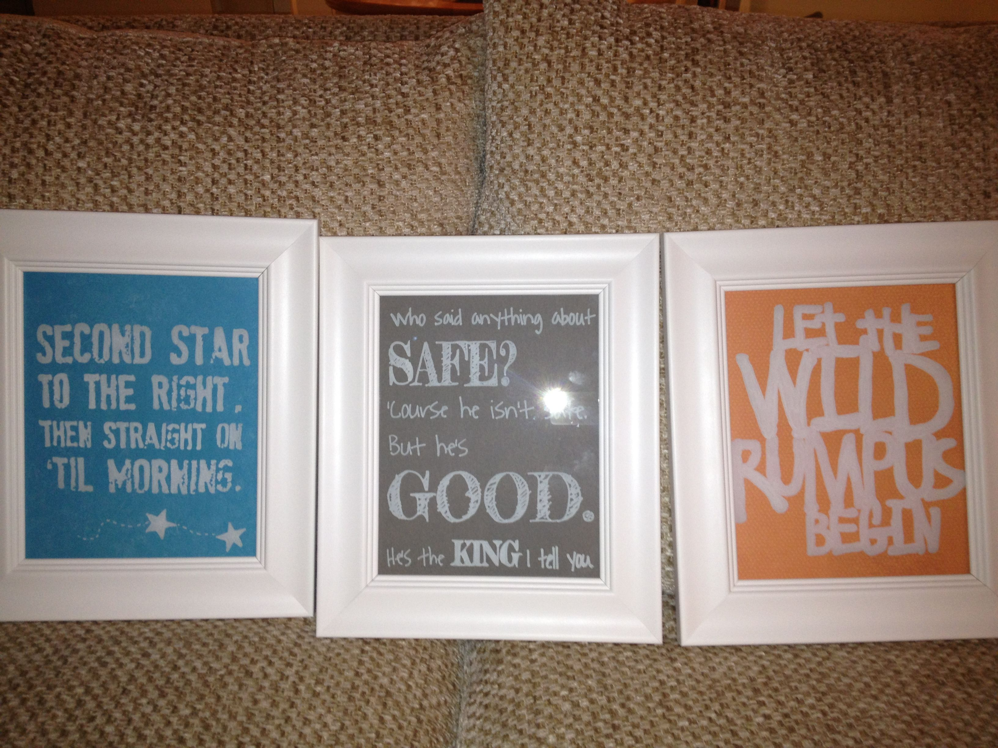 White Frames With Scrapbook Paper And Quotes Written On Glass
