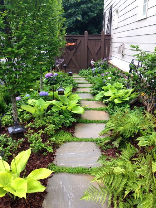 planted stepping stone path to side yard by southern roots studio