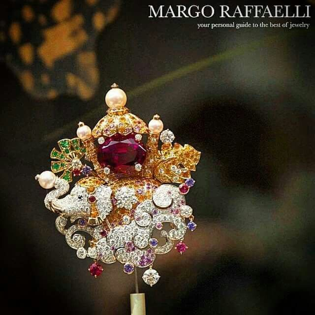 Look at this stupendously detailed @vancleefarpels Elephant Gold, diamonds, pink, purple, yellow and orange sapphires, emeralds, spessartite garnets, rubellites, white cultured pearl, one oval-cut rubellite of 14.84 cts make the perfect combination together ❤️⭐️ Spotted at #Biennale2014 Image : @hernameismargo