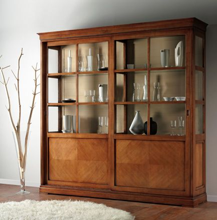Collection Charme Display cabinet with two sliding doors with herringbone working, beaded back, four internal drawers, four wooden shelves and four glass shelves . www.casanobile.it