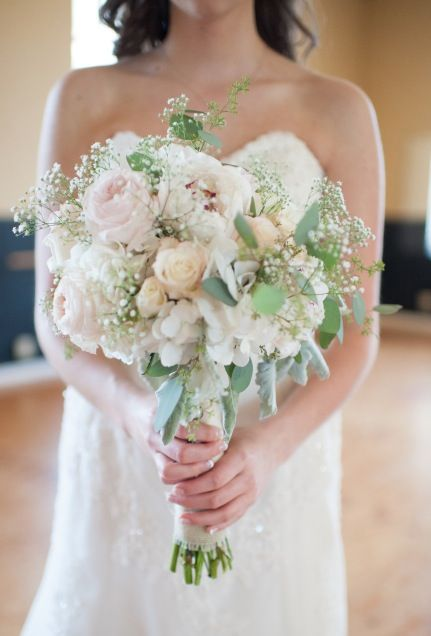 a romantic bridal bouquet of peonies garden roses hydrangeas and babys breath photo