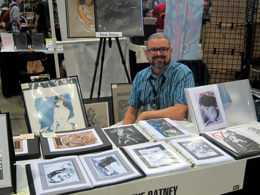"""ScienceFiction.com article by Dave Taylor - """"One of many artists in Artist's Valley, this is my friend Steve Oatney showing off some of his drawings."""" -- DENVER COMIC CON 2015 #DCCon #comics #comicons #conventions #art #artists #ArtistValley -- http://sciencefiction.com/2015/05/25/denver-comic-con-2015-cosplayers-come-play/"""