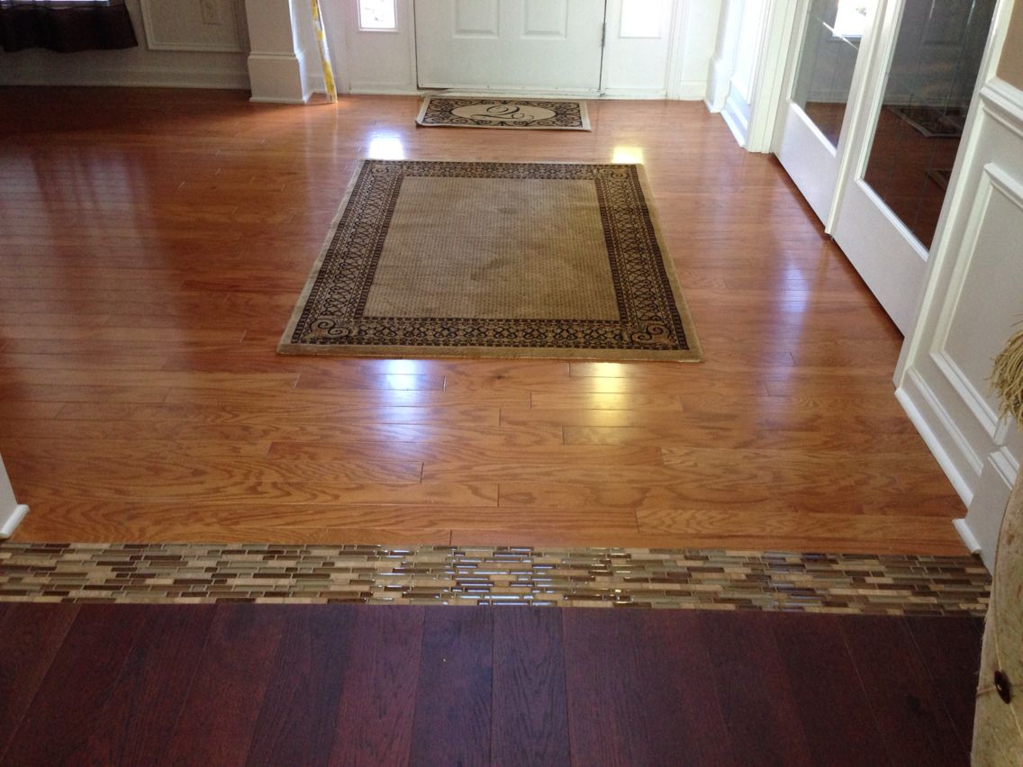 I just finished this project existing hardwood transitioning to existing hardwood transitioning to new 5 inch hickory with a glass tile threshold great idea to bring two different floors together dailygadgetfo Image collections