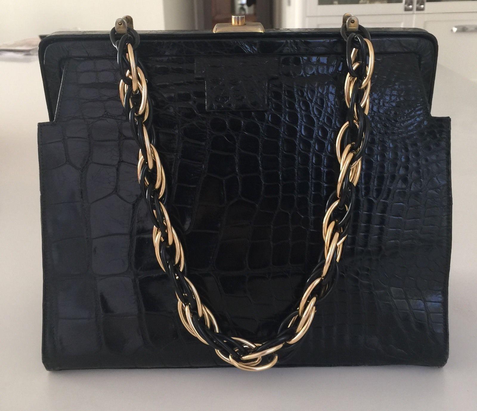 5ec4ef202285 Save 89% on the Saks Fifth Avenue Alligator Handbag Black Satchel! This  satchel is a top 10 member favorite on Tradesy.