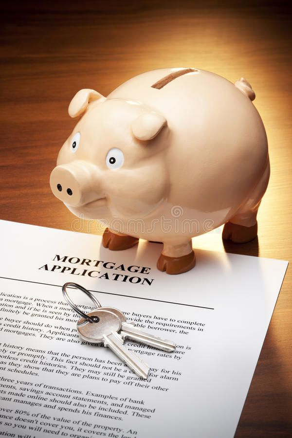 Mortgage Loan Piggy Bank Keys. A still life of a mortgage