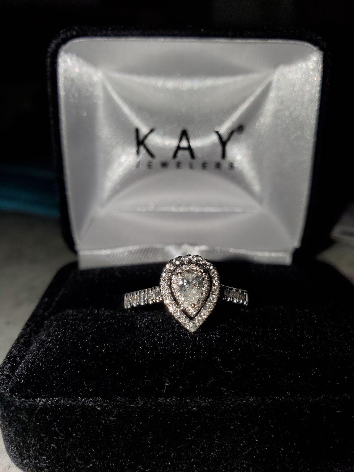 14k White Gold With 1 5 Carat Pear Shaped Diamond With Smaller Diamonds Surrounding Size 10 Kay Jewelers Rings Pear Shaped Diamond Rings