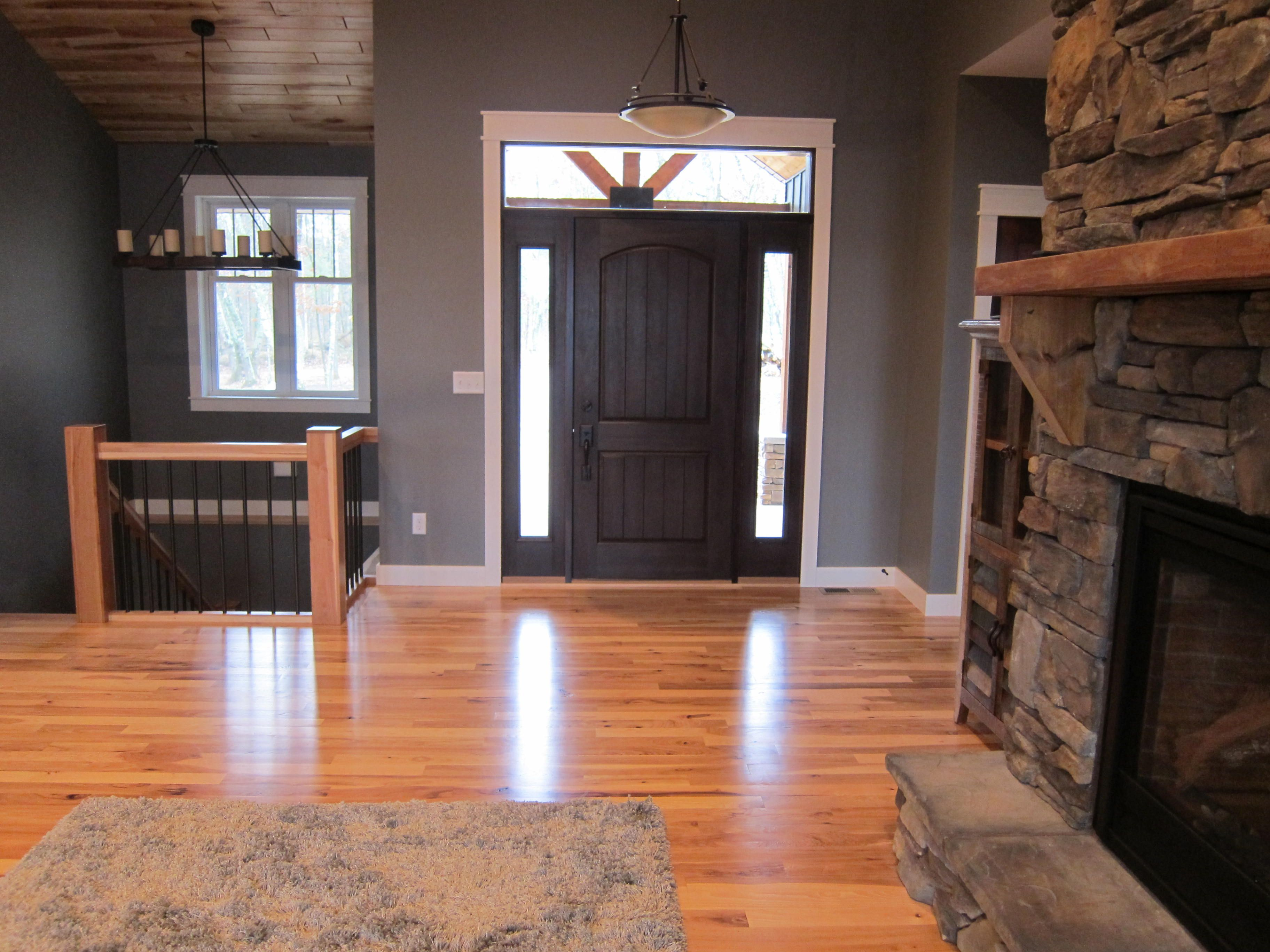 Standing In Great Room Looking At Front Entrance And Stairway