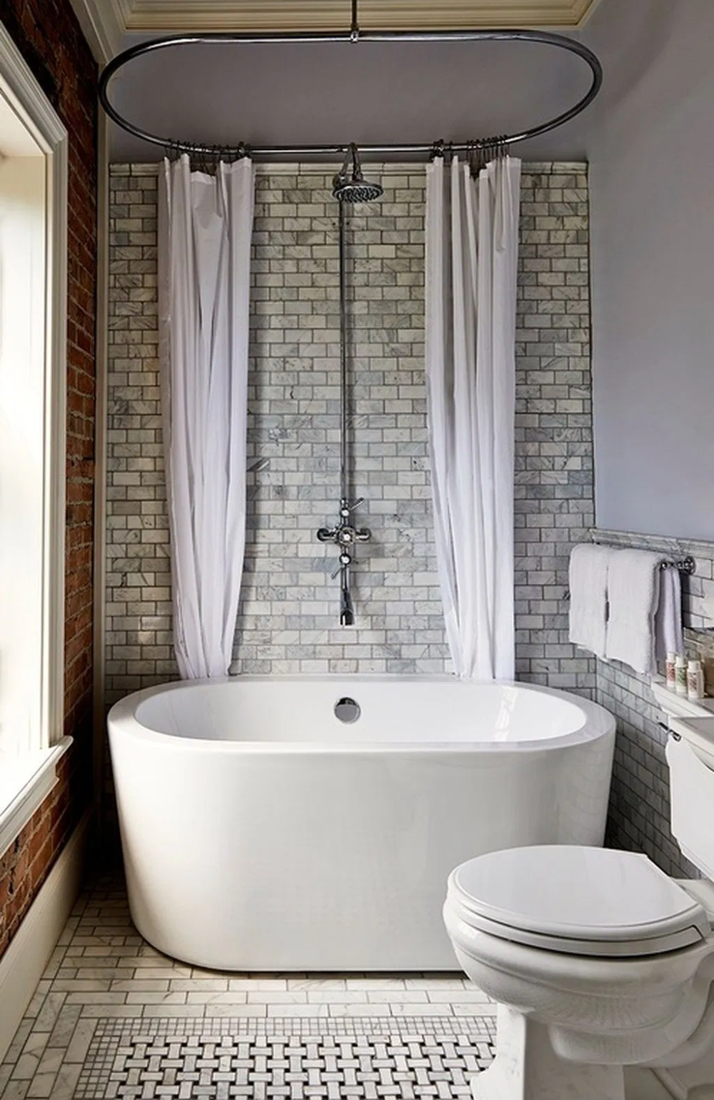 Minimalist White Bathroom With Elegant White Freestanding Bathtubs From Canada Stunning Seashore Resi With Images Shower Over Bath Small Bathtub Small Bathroom With Shower
