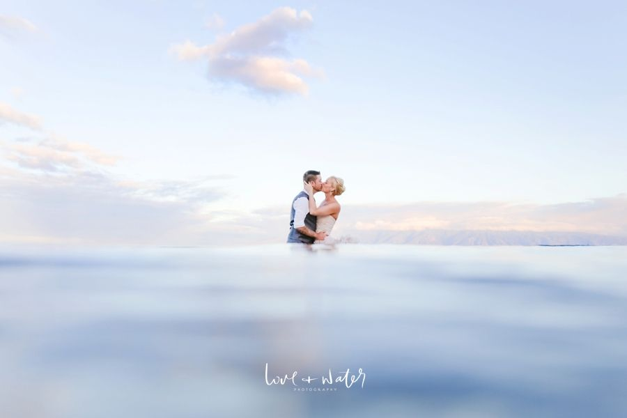 Maui Trash the Dress Photography at Sunrise in a pink ruffled wedding gown by Love and Water Photography