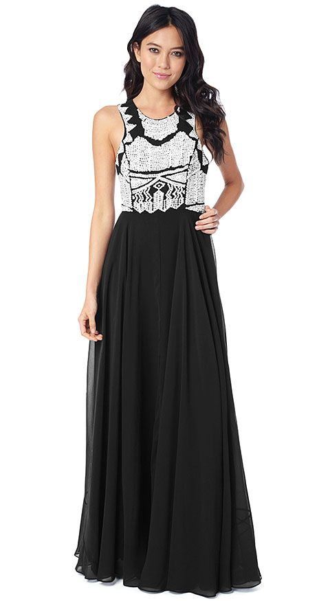 Make it a high contrast holiday with this stunning maxi dress in classic black and white.  By ParkerNY