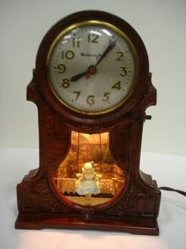 Master crafters swinging lady antique clock