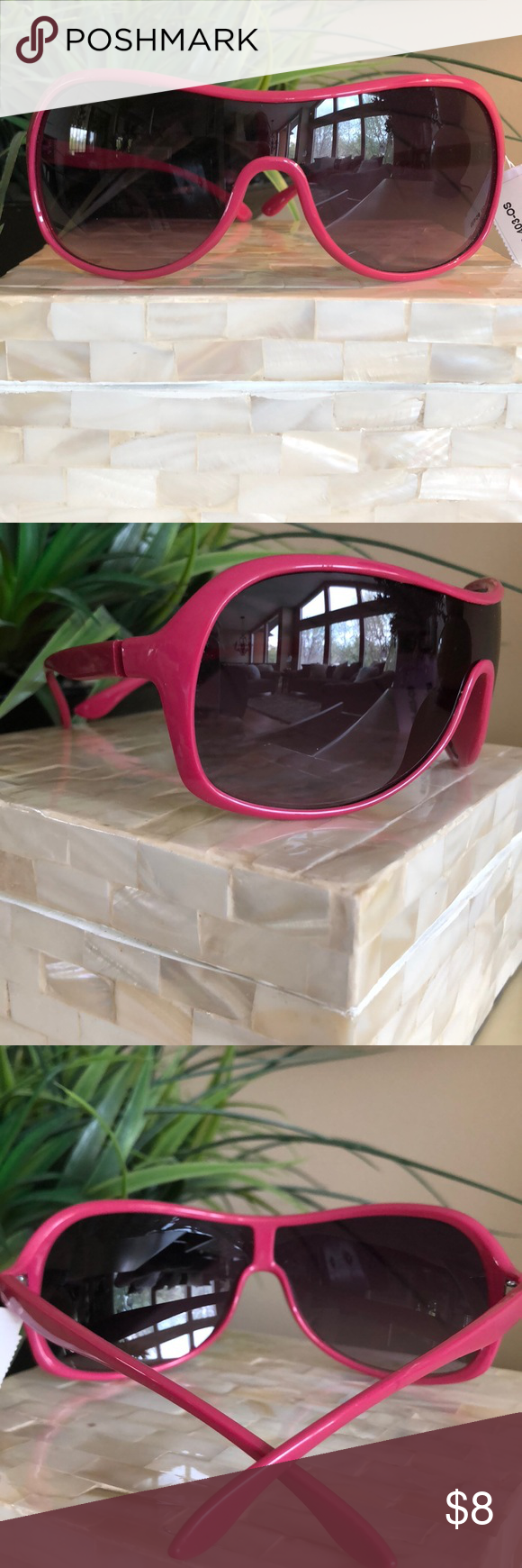 Pink Rim Shield Sunnies 100% UV Protection NWT Fun pink sunglasses with full UV Protection.  Purchased at a boutique last summer. They're lightweight and feature dark lenses. Great addition to your sunnnie collection! Boutique Accessories Sunglasses #pinkrims Pink Rim Shield Sunnies 100% UV Protection NWT Fun pink sunglasses with full UV Protection.  Purchased at a boutique last summer. They're lightweight and feature dark lenses. Great addition to your sunnnie collection! Boutique Accessori #pinkrims