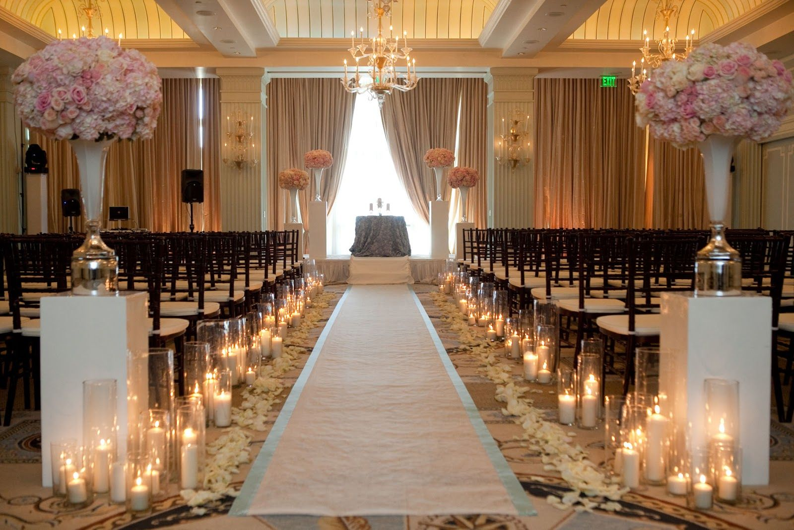 Warm romantic wedding ceremony with gazebo and pillars for Wedding walkway