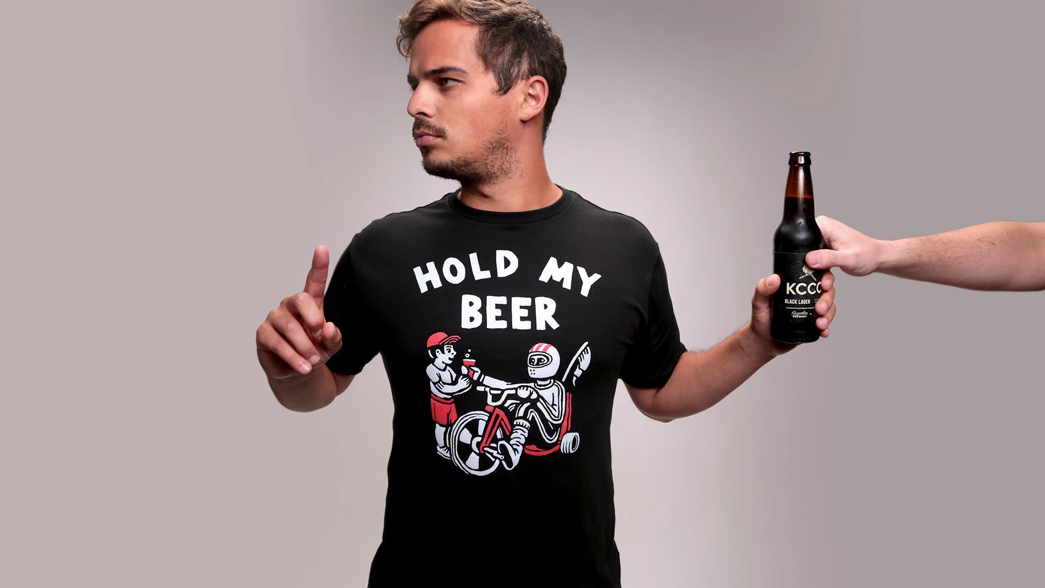 "Classic words were never more spoken than, ""Hold my beer!""You always know you are going to see something interesting (or dangerous) when someone says it.Double points if it comes from a member of your immediate family.Show us something special and grab the 'Hold My Beer' tee today!Designed by: Denton WattsHow Does It FitCustom cut and sewn to deliver a premium quality fit. Not too big or small, just right.Take Care of Your ShitMachine wash cold, inside out, with like colors...."